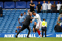 Sheffield United manager, Chris Wilder congratulates substitute Lys Mousset of Sheffield United during the Premier League match between Chelsea and Sheff United at Stamford Bridge, London, England on 31 August 2019. Photo by Carlton Myrie / PRiME Media Images.