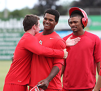 Batavia Muckdogs outfielder Mike O'Neil hugs Roberto Reyes as Virgil Hill looks on during the first day of practice for the start of the NY-Penn League season at the Dwyer Stadium in Batavia, New York;  June 13, 2011.  Photo By Mike Janes/Four Seam Images
