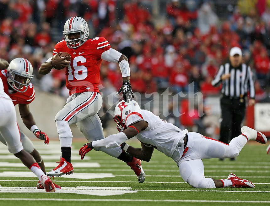 Ohio State Buckeyes quarterback J.T. Barrett (16) eludes the tackle attempt by Rutgers Scarlet Knights linebacker Steve Longa (3) during the third quarter of the NCAA football game at Ohio Stadium in Columbus on Oct. 18, 2014. (Adam Cairns / The Columbus Dispatch)