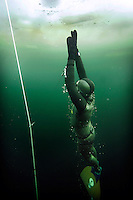 Steinar Schager ascending during freediving under the ice at Lutvann lake,outside Oslo, Norway. Photo: Fredrik Naumann/Felix Features