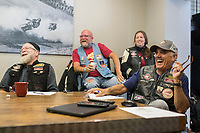 NWA Democrat-Gazette/CHARLIE KAIJO Club president Jim Hiland of Bentonville laughs along with members, Mark Goldsmith of Bella Vista, Mark Campbell of Bentonville and Wendy Widener of Gentry at the Heritage Indian Motorcycle club and show room in Rogers, AR on Saturday, September 9, 2017. The Indian riders gathered to discuss plans for the upcoming Bikes, Blues and BBQ rally