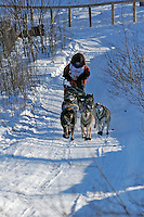 Saturday, February 24th, Knik, Alaska.  Jr. Iditarod musher Jeff Holt on the trail shortly after leaving the Knik start