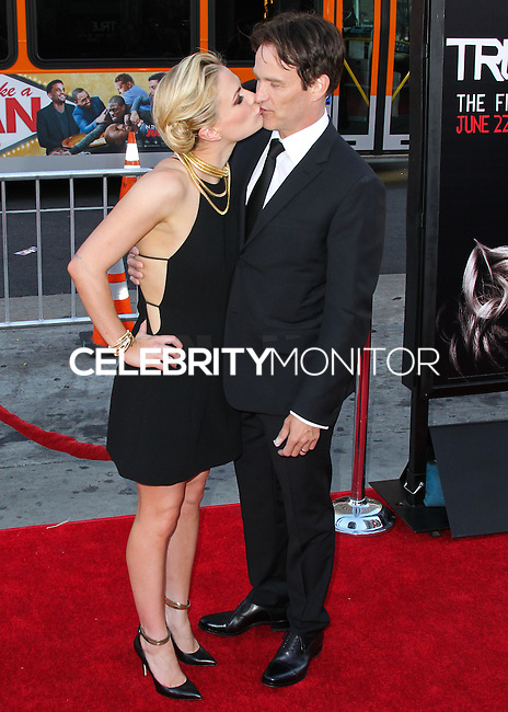 HOLLYWOOD, LOS ANGELES, CA, USA - JUNE 17: Actors Anna Paquin and Stephen Moyer kissing at the Los Angeles Premiere Of HBO's 'True Blood' Season 7 held at the TCL Chinese Theatre on June 17, 2014 in Hollywood, Los Angeles, California, United States. (Photo by Xavier Collin/Celebrity Monitor)