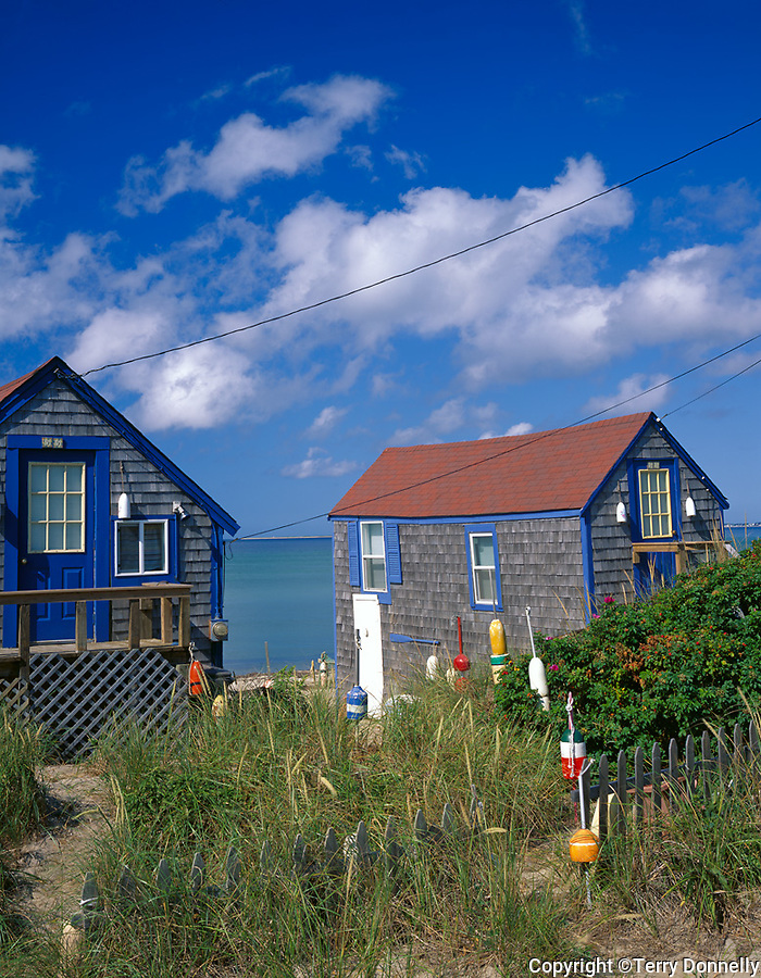 Cape Cod National Seashore, MA<br /> Pair of restored fishing shacks with decorative lobster bouys on the beach at Cape Cod Bay near Truro