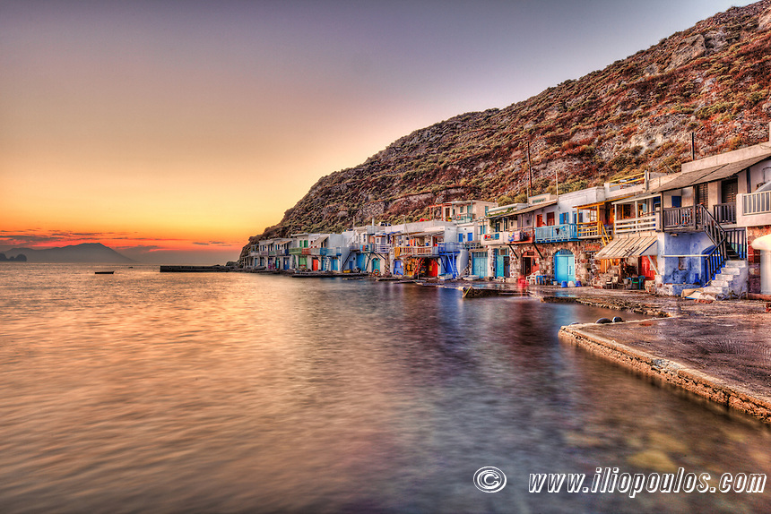 "Sunset at the fishermen houses with the impressive boat shelters, also known as ""syrmata"" in Klima of Milos, Greece"