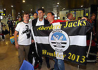 Wednesday 18 September 2013<br /> Pictured: Manager Michael Laudrup (C) posing with Swansea supporters from Aberdare south Wales upon his arrival to Valencia Airport.<br /> Re: Swansea City FC players and staff travelling to Spain for their UEFA Europa League game against Valencia.