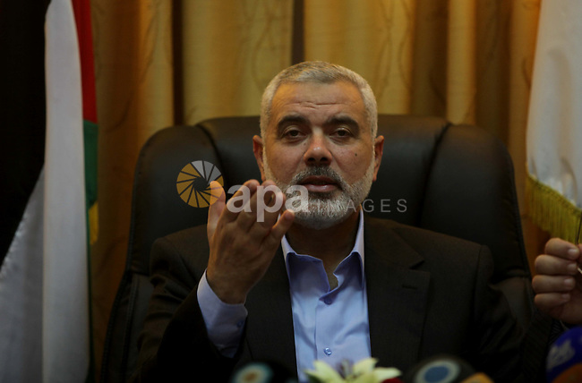 Palestinian Prime Minister in Gaza, Ismail Haniyeh, speaks at a meeting during his visit to the Court of eliminating the legitimate, in Gaza City on Dec. 04, 2013. Photo by Ashraf Amra