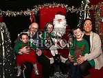 Patrick, Duireann and Naoise Lennon with their parents visiting Santa at the Laurence Centre.