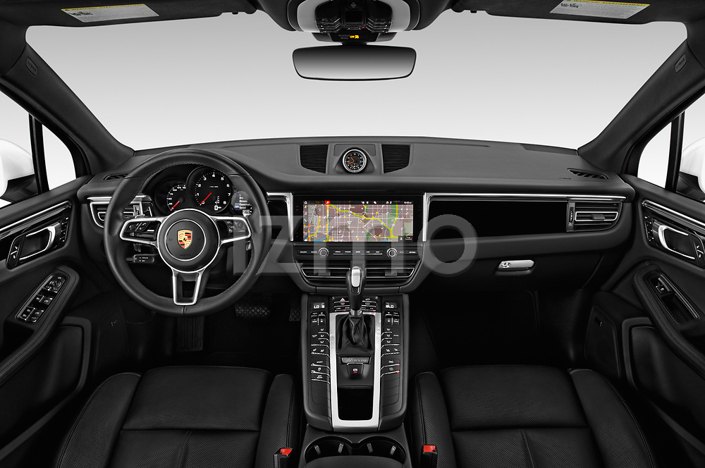Stock photo of straight dashboard view of a 2019 Porsche Macan Base 5 Door SUV