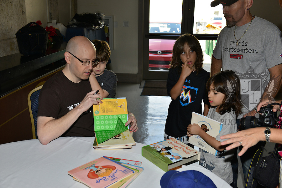 """CORAL GABLES, FL - JANUARY 09: Author Brad Meltzer sign copy of his """"I Am Martin Luther King, Jr."""" at  The Family Day Block Party first annual block party with activity in Coral Gables art Cinema and Coral Gables Museum presented by Books and Books at Aragon Avenue in Coral Gables on Saturday January 9, 2016 in Coral Gables, Florida.  ( Photo by Johnny Louis / jlnphotography.com )"""