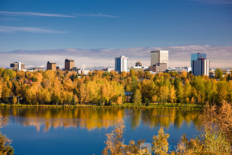 The downtown Anchorage Skyline with fall foliage reflected in Westchester Lagoon, Anchorage, fall, Anchorage, Southcentral Alaska, USA.