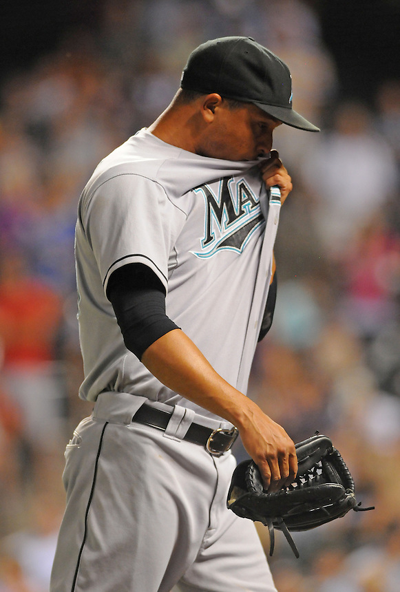 15 AUGUST 2011: Florida Marlins relief pitcher Leo Nunez (46) is frustrated after being pulled from the game after giving up the tying run   during a regular season game between the Florida Marlins and the Colorado Rockies at Coors Field in Denver, Colorado. The Rockies beat the Marlins 7-4. *****For Editorial Use Only*****