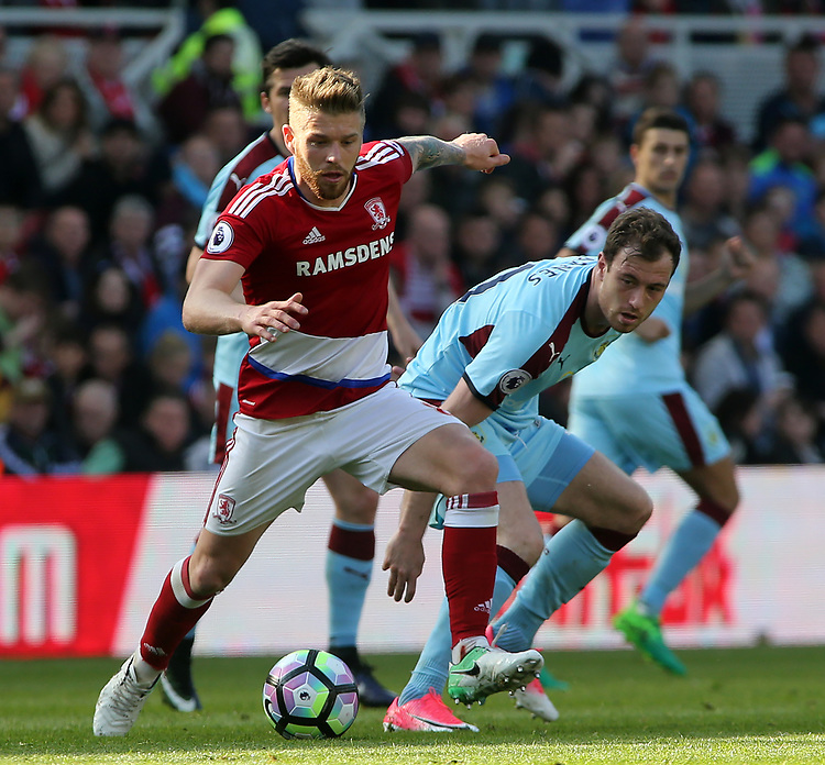 Middlesbrough's Adam Clayton gets away from Burnley's Ashley Barnes<br /> <br /> Photographer David Shipman/CameraSport<br /> <br /> The Premier League - Middlesbrough v Burnley - Saturday 8th April 2017 - Riverside Stadium - Middlesbrough<br /> <br /> World Copyright &copy; 2017 CameraSport. All rights reserved. 43 Linden Ave. Countesthorpe. Leicester. England. LE8 5PG - Tel: +44 (0) 116 277 4147 - admin@camerasport.com - www.camerasport.com