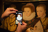 "Three Unknown Elizabethan Children"" on a mobile phone display. Press preview of the exhibition ""Elizabeth I & Her People"" at the National Portrait Gallery which explores the remarkable reign of Elizabeth I through the lives and portraiture of her subjects. Exhibition runs from 10 October 2013 to 5 January 2014."