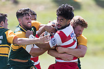 Cardiff Vaega gets wrapped up by Trent White, Jared Page and Josh Baverstock. Counties Manukau Premier Counties Power Club Rugby game between Karaka and Pukekohe, played at the Karaka Sports Park on Saturday March 10th 2018. Pukekohe won the game 31 - 27 after trailing 5 - 20 at halftime.<br /> Photo by Richard Spranger.