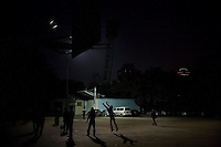 Young men play basketball late in the evening at the Wu Tai Shan athletics complex in central Nanjing, China.