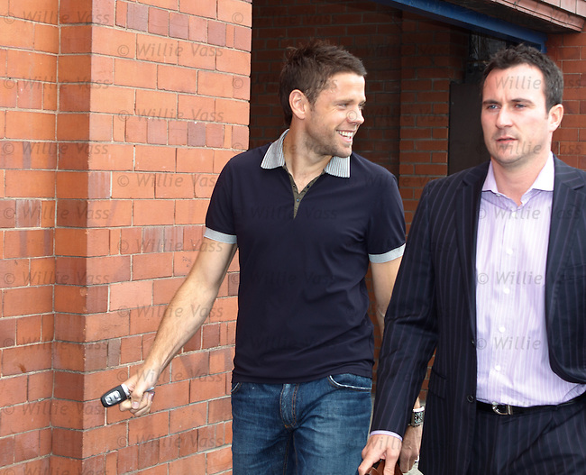Striker James Beattie leaving Ibrox Stadium at lunchtime beaming from ear to ear