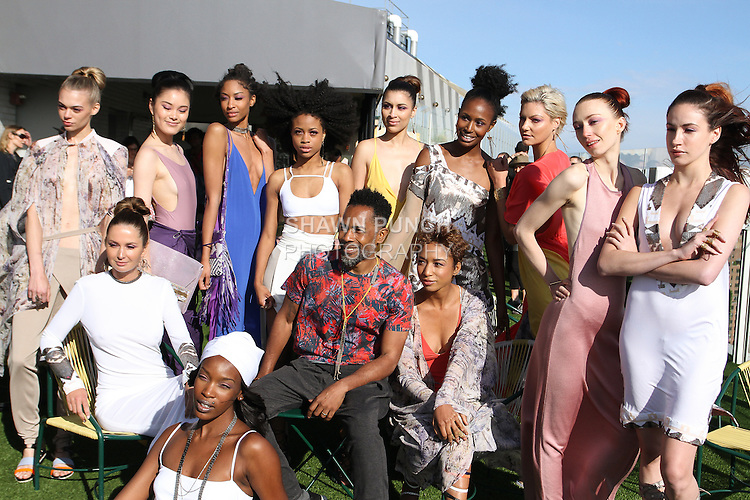 Fashion designer Carlton Jones poses with models after his Carlton Jones Resort 2017 runway show at Le Bain in The Standard Hotel in New York City, on June 8, 2017.