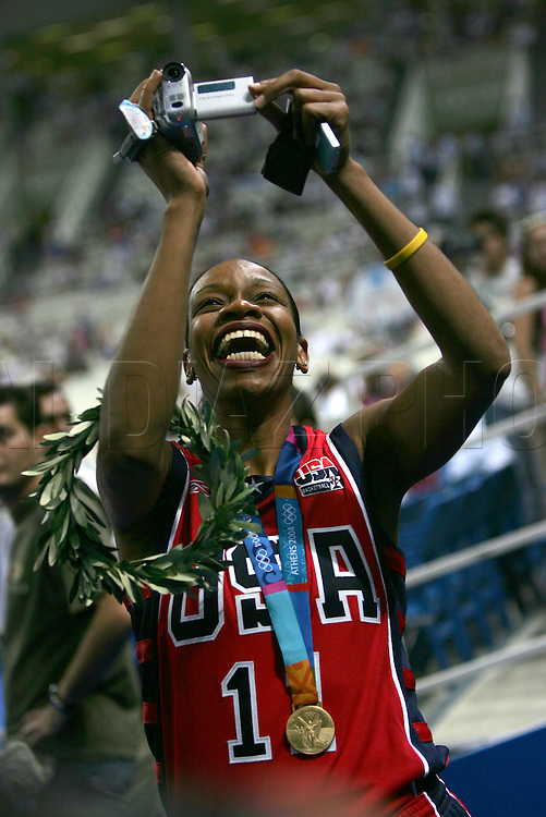 8/28/04 --Al Diaz/Miami Herald/KRT--Athens, Greece--Lituania vs USA during the Athens 2004 Olympic Games at Olympic Indoor Hall. USA wins the Bronze Medal defeating LTU 96-104. Here, USA's women's basketball player Tina Thompson out to see the men's game.