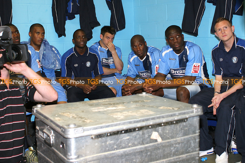 Wycombe players, Chris Zebroski, Nathan Ashton, Matt Bloomfield, Frank Sinclair, John Akinde and Stuart Beavon anxiously watch the tv in the dressing room and wait for the other results in the Division to come through to see if they have won promotion during Wycombe Wanderers vs Notts County, Coca Cola League Division Two Football at Adams Park on 2nd May 2009