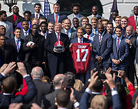 United States President Donald J. Trump poses for photos with Coach Nick Saban and members of the 2017 NCAA Football National Champions: The Alabama Crimson Tide during their welcoming ceremony at the White House in Washington, DC, March 10, 2018. <br /> CAP/MPI/RS<br /> &copy;RS/MPI/Capital Pictures