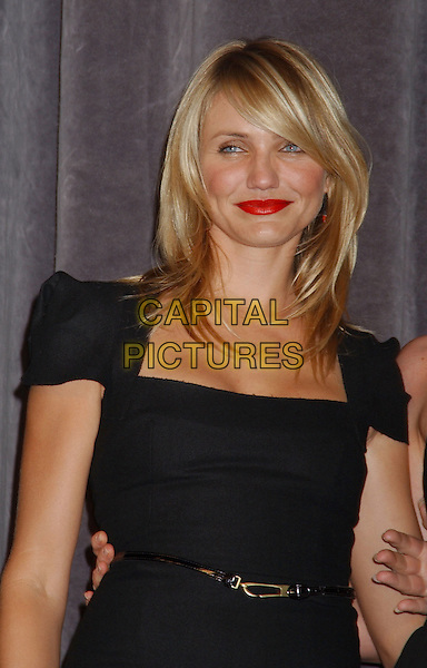 CAMERON DIAZ.At the 'In Her Shoes' Premiere,.The Toronto Film Festival,.Toronto, 14th September 2005.half length red lip lipstick black dress fitted belt.Ref: ADM/LF.www.capitalpictures.com.sales@capitalpictures.com.© Capital Pictures.
