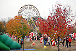 A ferris wheel sits among the fall colors at the Lanier Law Firm's Holiday Bash Sunday Dec. 13,2009.(Dave Rossman/For the Chronicle)
