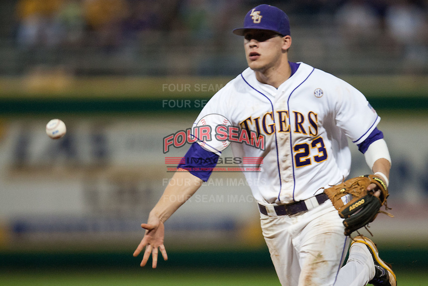 LSU Tigers second baseman JaCoby Jones #23 tosses the ball to first base against the Mississippi State Bulldogs during the NCAA baseball game on March 16, 2012 at Alex Box Stadium in Baton Rouge, Louisiana. LSU defeated Mississippi State 3-2 in 10 innings. (Andrew Woolley / Four Seam Images)