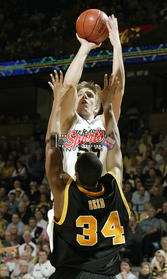 Wake Forest center Kyle Visser (55) raises up to shoot over VCU forward Derrick Reid (34) during the second half of the #2 Demon Deacons 81-67 victory over Virginia Commonwealth, November 18, 2004.