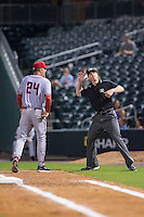 Syracuse Chiefs manager Billy Gardner Jr. (24) is thrown out of the game by first base umpire Alex Tosi after arguing a home run call during the game against the Charlotte Knights at BB&T BallPark on June 1, 2016 in Charlotte, North Carolina.  The Knights defeated the Chiefs 5-3.  (Brian Westerholt/Four Seam Images)