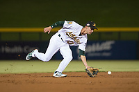 Mesa Solar Sox shortstop Eli White (21), of the Oakland Athletics organization, fields a ground ball during an Arizona Fall League game against the Scottsdale Scorpions at Sloan Park on October 10, 2018 in Mesa, Arizona. Scottsdale defeated Mesa 10-3. (Zachary Lucy/Four Seam Images)