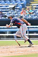 Rome Braves catcher Lucas Herbert (14) runs to first during a game against the Asheville Tourists at McCormick Field on August 21, 2016 in Asheville, North Carolina. The Braves defeated the Tourists 4-2. (Tony Farlow/Four Seam Images)