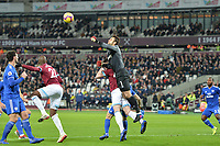 Lukasz Fabianski of West Ham United `punches a cross during West Ham United vs Cardiff City, Premier League Football at The London Stadium on 4th December 2018