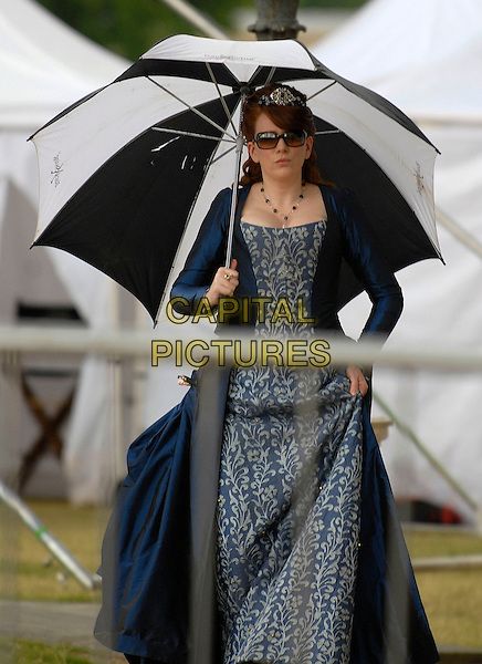"""CATHERINE TATE .On the film set of """"Gulliver's Travels"""" in Greenwich, South East London, England, UK, June 1st 2009..filmset movie on location filming half length umbrella sunglasses blue period costume dress tiara .CAP/IA.©Ian Allis/Capital Pictures"""