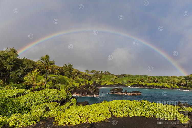 Wai'napanapa Bay, with black sand beach and double rainbow, road to Hana, Maui.