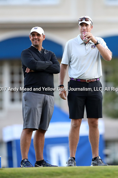 DURHAM, NC - SEPTEMBER 16: Liberty head coach Jeff Thomas (left) and East Carolina head coach Andrew Sapp (right). The first round of the Rod Myers Invitational Men's Golf Tournament was held on September 16, 2017, at the Duke University Golf Club in Durham, NC.
