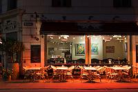 Empty tables await diners arrival at Cafe Oscar in Bredgade, Copenhagen, Denmark