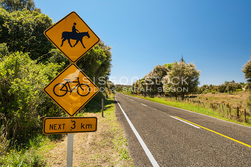 Road warning sign for motorists of horse riders and bicyclers on a country road in Golden Bay, South Island, New Zealand - stock photo, canvas, fine art print