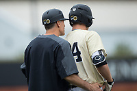 Wake Forest Demon Deacons head coach Tom Walter (16) gives instructions to Gavin Sheets (24) during the game against the Georgia Tech Yellow Jackets at David F. Couch Ballpark on March 26, 2017 in  Winston-Salem, North Carolina.  The Demon Deacons defeated the Yellow Jackets 8-4.  (Brian Westerholt/Four Seam Images)