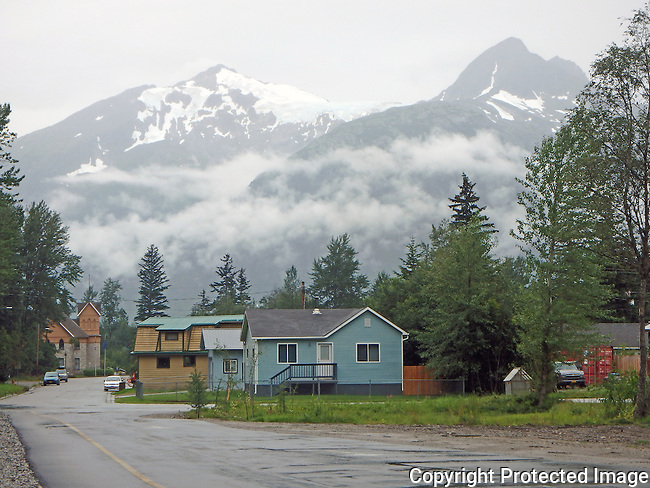 snow capped mountains over a residential street in the gold rush town of Skagway, Alaska