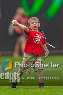 9 June 2013: Washington Nationals Director of Media Relations Mike Gazda's 4-year old son Josh tosses a baseball in right field prior to a game between the Minnesota Twins and the Washington Nationals at Nationals Park in Washington, DC. The Nationals shut out the Twins 7-0 in the first game of their day/night double-header. Mandatory Credit: Ed Wolfstein Photo *** RAW (NEF) Image File Available ***