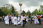 Charlton-on-Otmoor Oxfordshire May Day Celebrations. Children from the Church of England St Mary the Virgin Primary School process to the village church to have their May garlands blessed. The garlands are then hung on the church Rood Screen. After the May service children take part in traditional May pole dances in the car park of the Crown Inn.