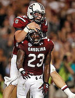 South Carolina quarterback Connor Shaw and South Carolina wide receiver Bruce Ellington celebrate after a 26-yard touchdown pass and catch between the pair to put the Gamecocks up 28-0 on Vanderbilt at Williams-Brice Stadium on Saturday.