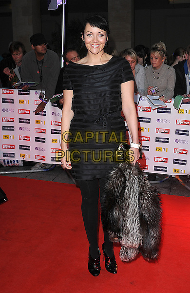 MARTINE McCUTCHEON.The Pride of Britain Awards, Grosvenor House, Hotel, Park lane, London, England. .October 5th, 2009.full length black dress waist belt tights striped patent booties shooboots shoe boots .CAP/BEL.©Tom Belcher/Capital Pictures.