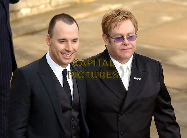 DAVID FURNISH & SIR ELTON JOHN.Sir Elton Johm & David Furnish - civil partnership ceremony (wedding) at Guildhall, Windsor, Berkshire, England..Deccember 21st, 2005.Ref: FIN.headshot portrait tinted glasses black suit.www.capitalpictures.com.sales@capitalpictures.com.© Capital Pictures.