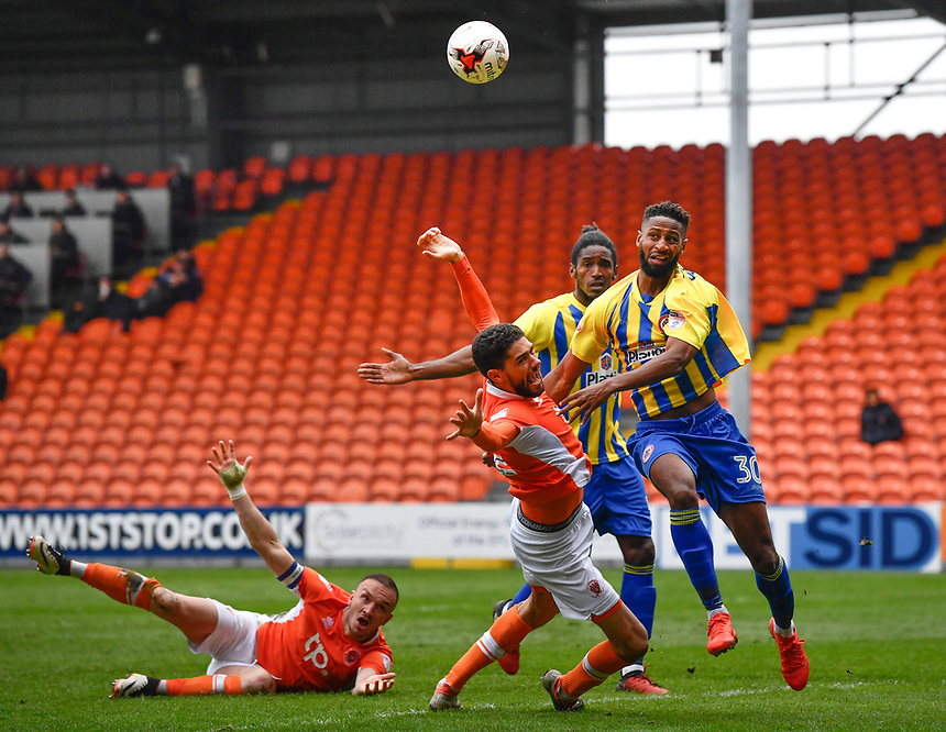 Blackpool's Kelvin Mellor battles with Accrington Stanley's Janoi Donacien <br /> <br /> Photographer Terry Donnelly/CameraSport<br /> <br /> The EFL Sky Bet League Two - Blackpool v Accrington Stanley - Friday 14th April 2017 - Bloomfield Road - Blackpool<br /> <br /> World Copyright &copy; 2017 CameraSport. All rights reserved. 43 Linden Ave. Countesthorpe. Leicester. England. LE8 5PG - Tel: +44 (0) 116 277 4147 - admin@camerasport.com - www.camerasport.com