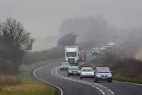 Cars and lorry drive along foggy road, Oxfordshire,  United Kingdom