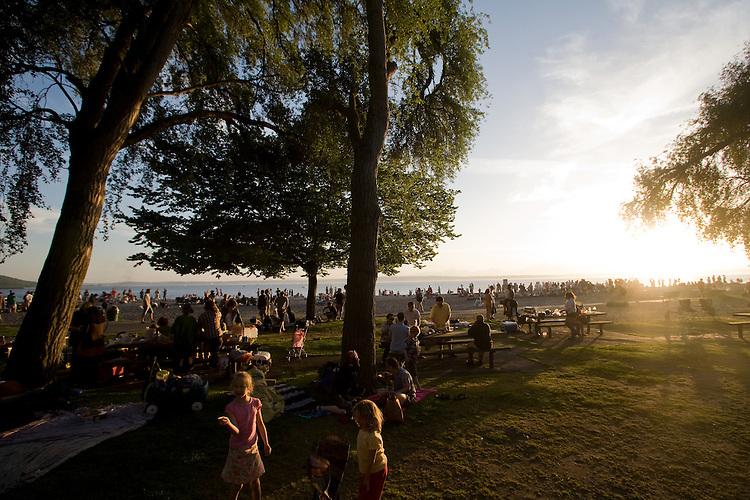Golden Gardens park, Seattle, Ballard, Puget Sound, Washington State, USA, Pacific Northwest, Summertime crowd at sunset,