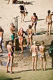 USA, Hawaii, Oahu, people rinse off at the beach shower, Waimea Bay