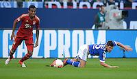 FUSSBALL   1. BUNDESLIGA  SAISON 2012/2013   4. Spieltag FC Schalke 04 - FC Bayern Muenchen      22.09.2012 Luiz Gustavo (li, FC Bayern Muenchen) gegen Klaas Jan Huntelaar (FC Schalke 04)
